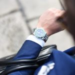 person looking at their watch. Time sensitive interim recruitment