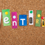 The word mentoring in colourful letters on a pin board