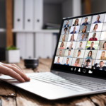 laptop with a virtual meeting taking place onscreen